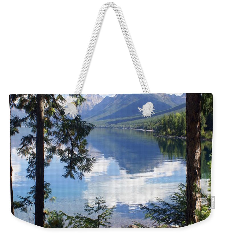 Glacier National Park Weekender Tote Bag featuring the photograph Lake Mcdlonald Through The Trees Glacier National Park by Marty Koch