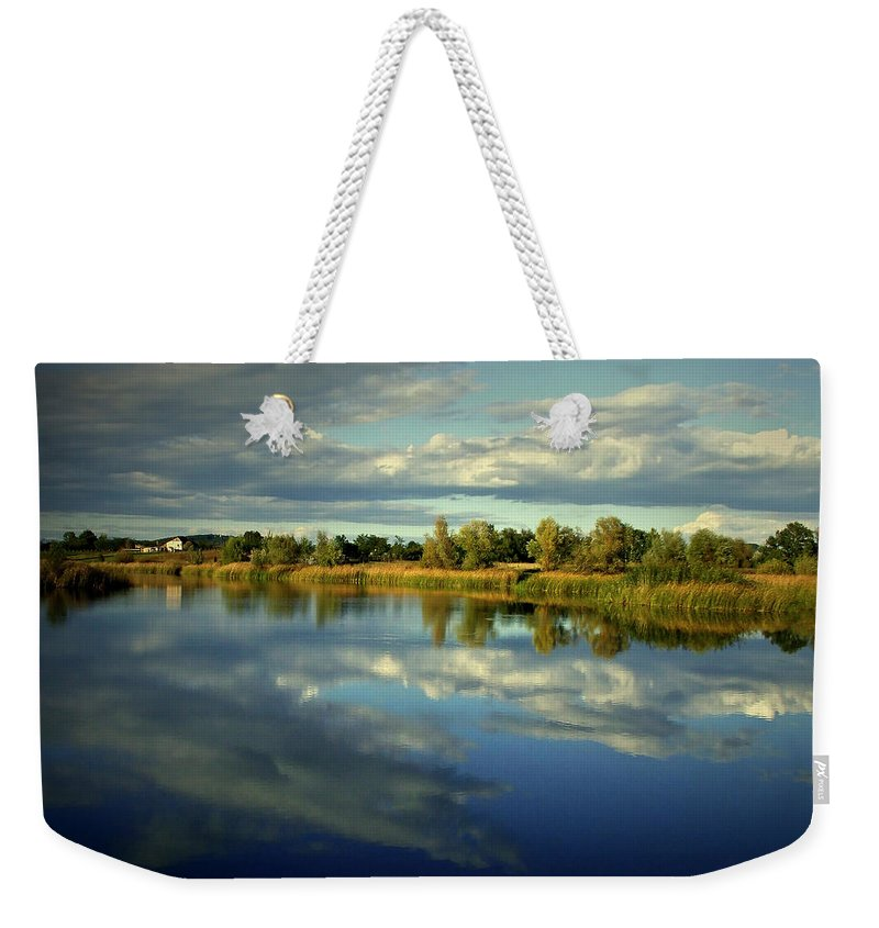 Lake Weekender Tote Bag featuring the pyrography Lake Of The Clouds by Vacarciuc Bogdan