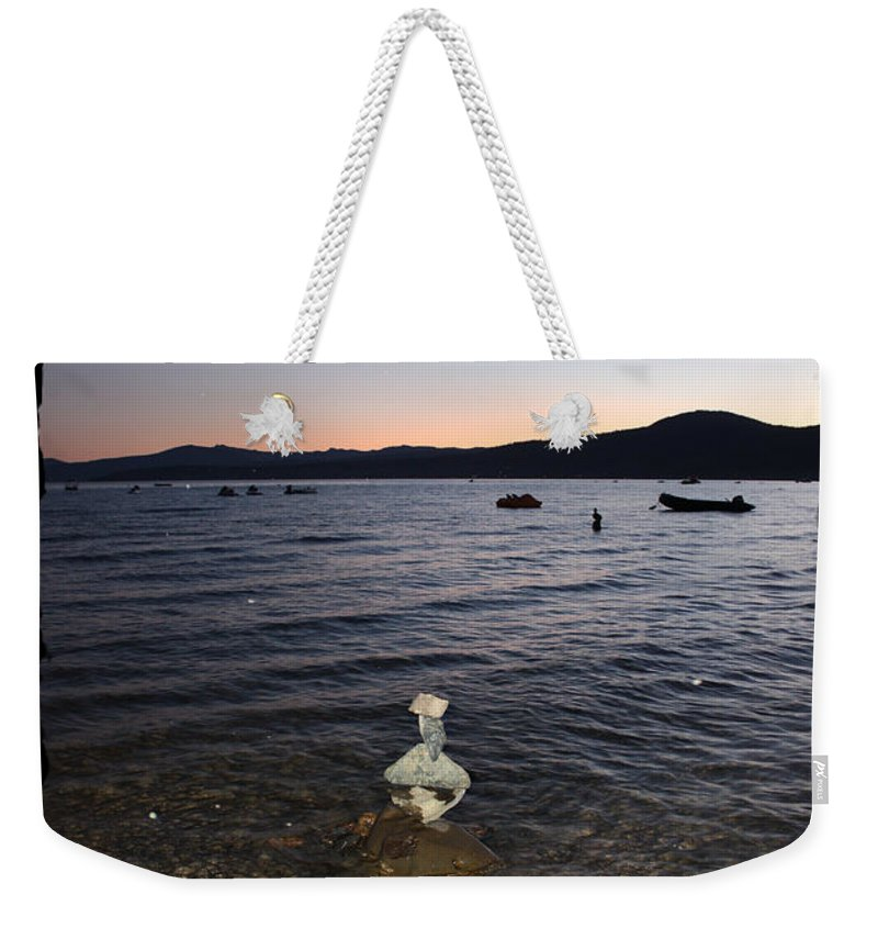 Lake Tahoe Weekender Tote Bag featuring the photograph Lake Tahoe Sunset With Rocks And Black Framing by Carol Groenen
