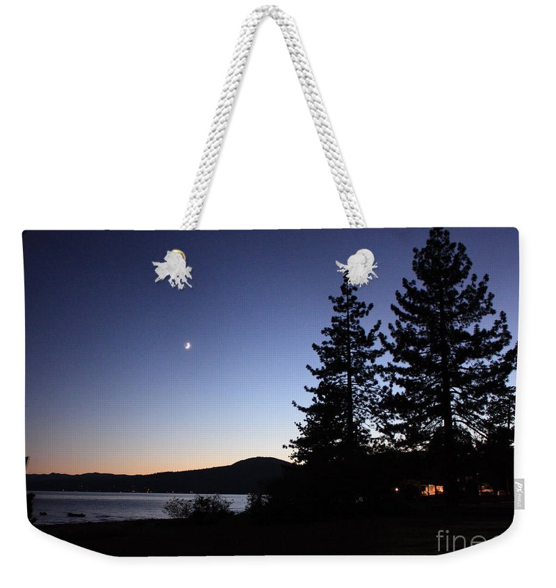 Lake Tahoe Sunset Weekender Tote Bag featuring the photograph Lake Tahoe Sunset With Trees And Black Framing by Carol Groenen