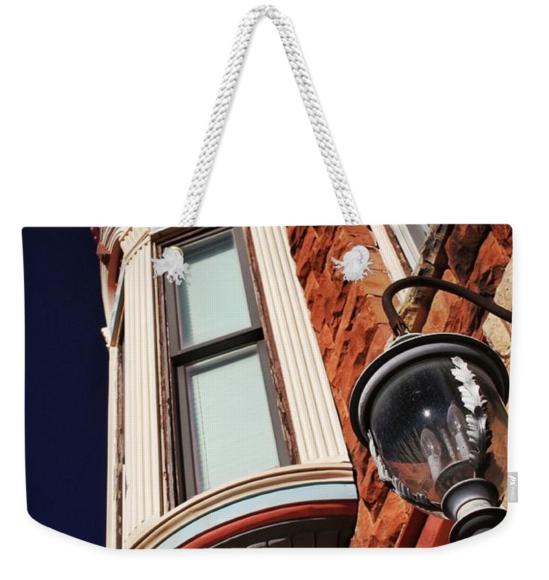 Guthrie Weekender Tote Bag featuring the photograph Lamp And Building Details by Buck Buchanan