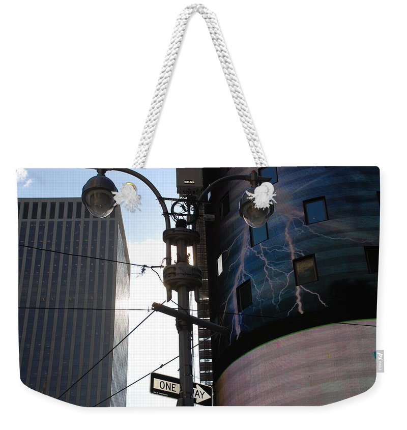 Scenic Weekender Tote Bag featuring the photograph Lampost And Lightning by Rob Hans