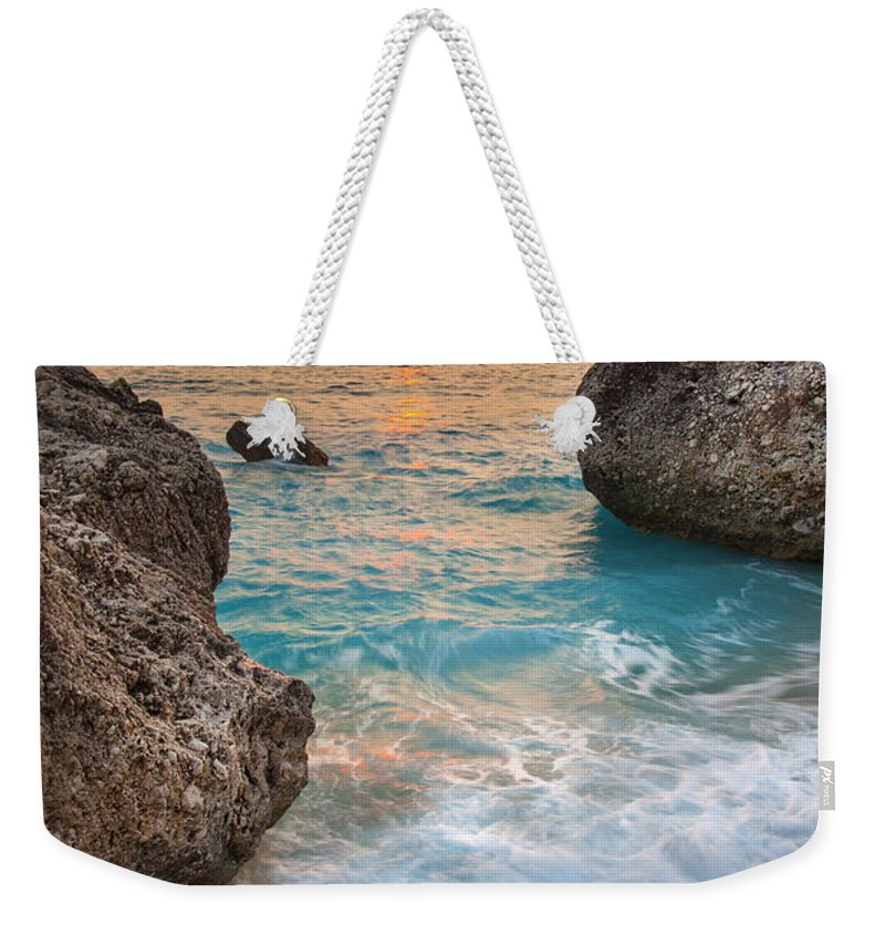 Beach Weekender Tote Bag featuring the photograph Large Rocks And Wave With Sunset On Paradise Island Greece by Sandra Rugina