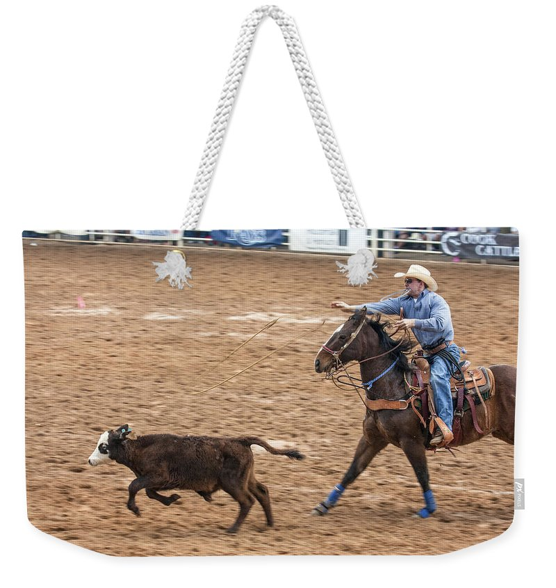 Rodeo Weekender Tote Bag featuring the photograph Lassoing The Calf by Sally Weigand