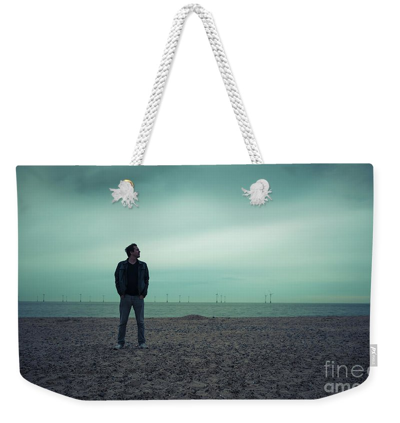 Bay Weekender Tote Bag featuring the photograph Last Man by Svetlana Sewell