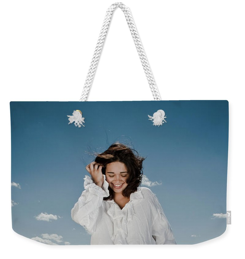 Woman Weekender Tote Bag featuring the photograph Laughing Sky by Scott Sawyer