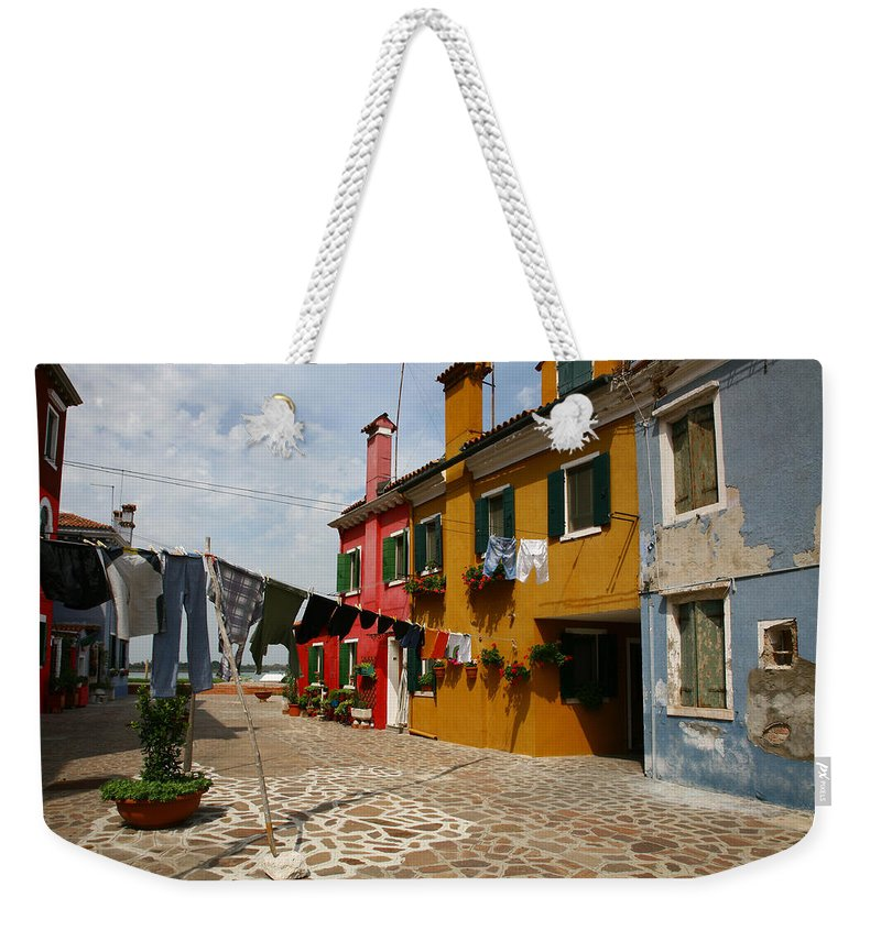 Laundry Weekender Tote Bag featuring the photograph Laundry Held By Wooden Pole by Donna Corless