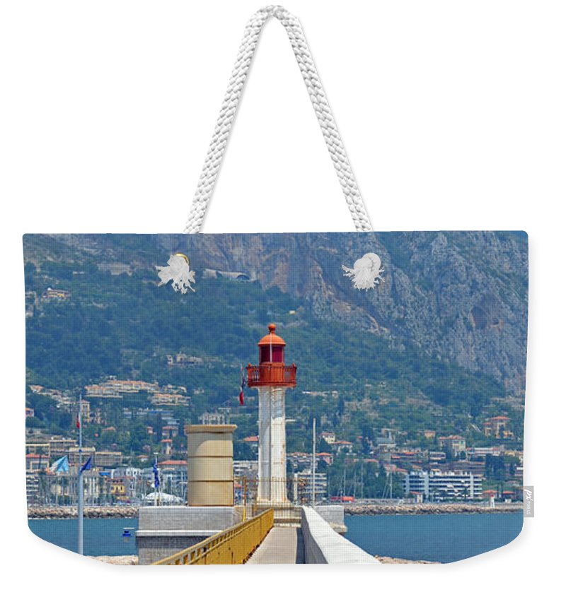 Lighthouse Weekender Tote Bag featuring the photograph Le Phare by Corinne Rhode