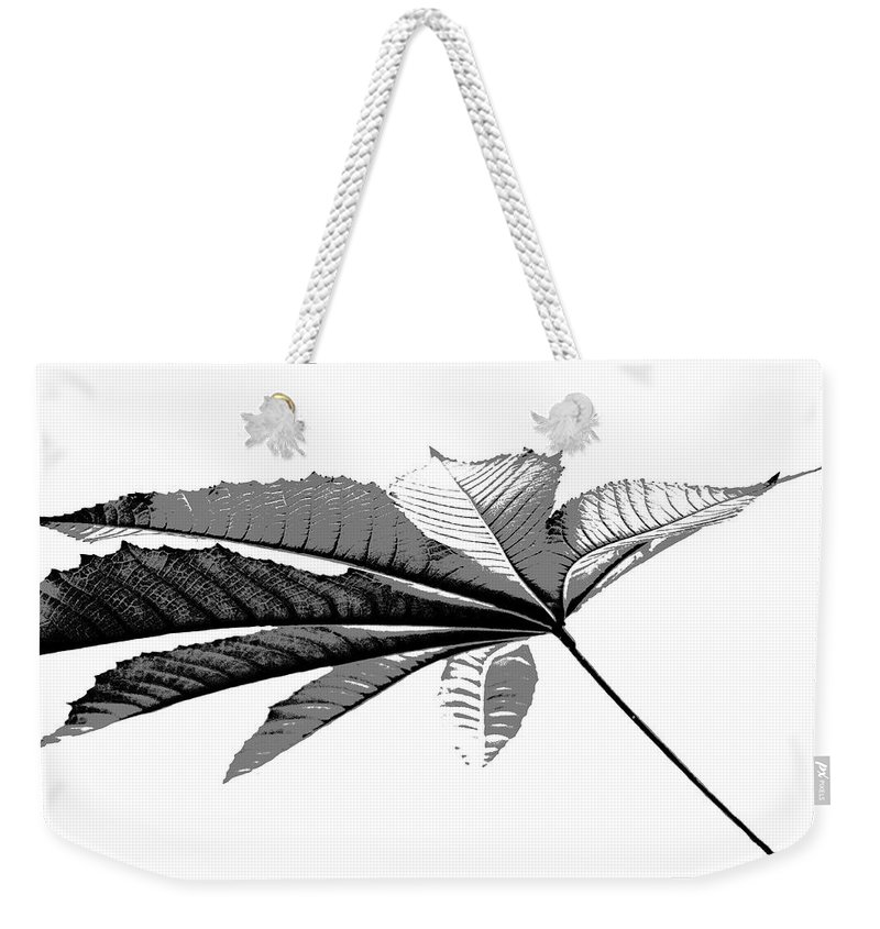 Leaf Weekender Tote Bag featuring the photograph Leaf In Black And White by Elva Robinson