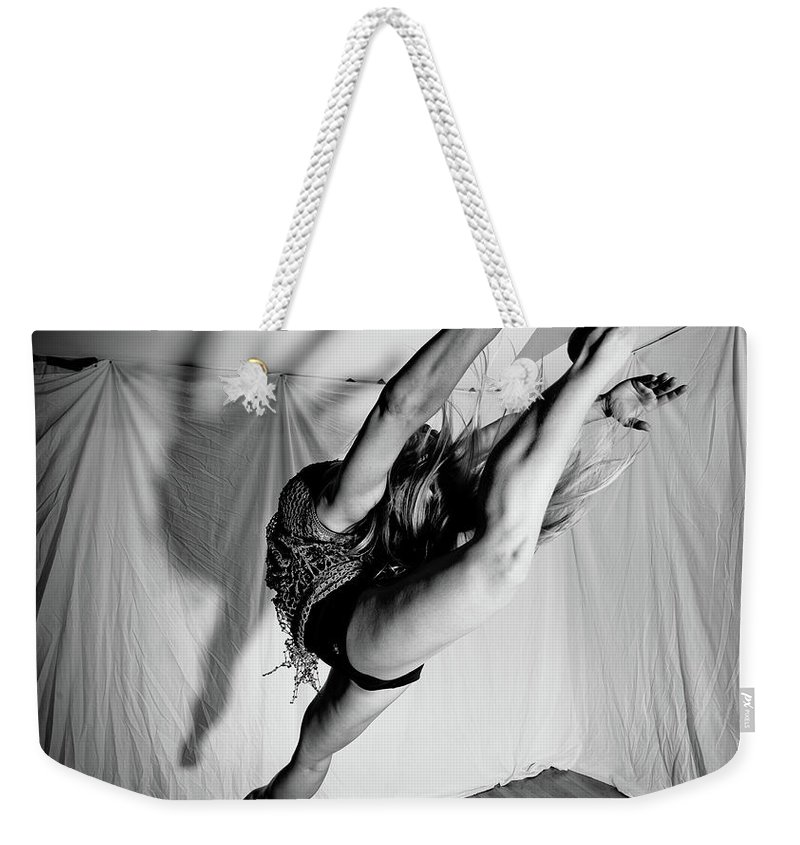 Dance Weekender Tote Bag featuring the photograph Leaping In Studio by Scott Sawyer