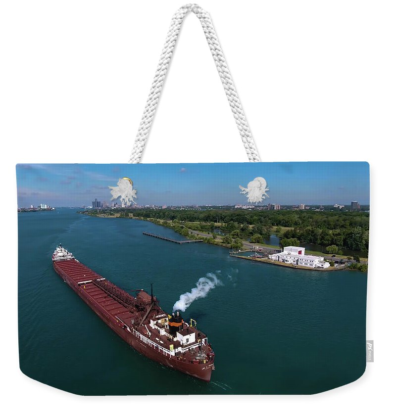 Gales Of November Weekender Tote Bag featuring the photograph Lee Tregurtha Off Belle Isle by Gales Of November