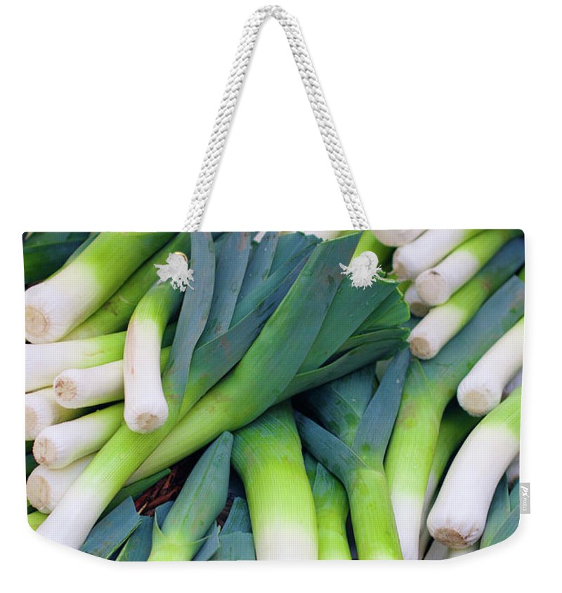 Leek Weekender Tote Bag featuring the photograph Leeks At The Farmer's Market by Bruce Block
