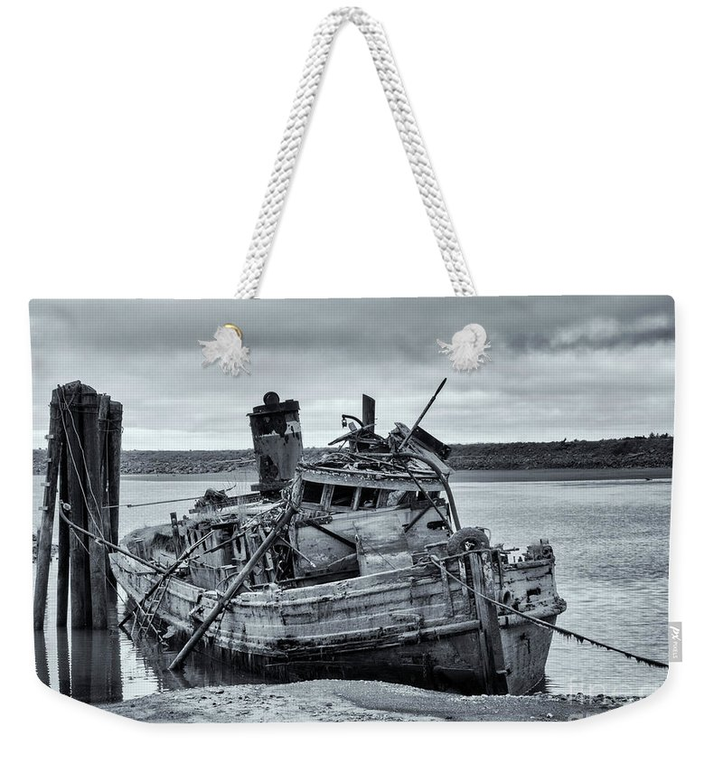 Mary D Hume Weekender Tote Bag featuring the photograph Left To Rot by Mike Dawson