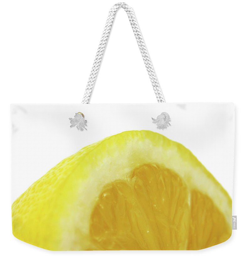 Lemon Weekender Tote Bag featuring the digital art Lemon by Mery Moon