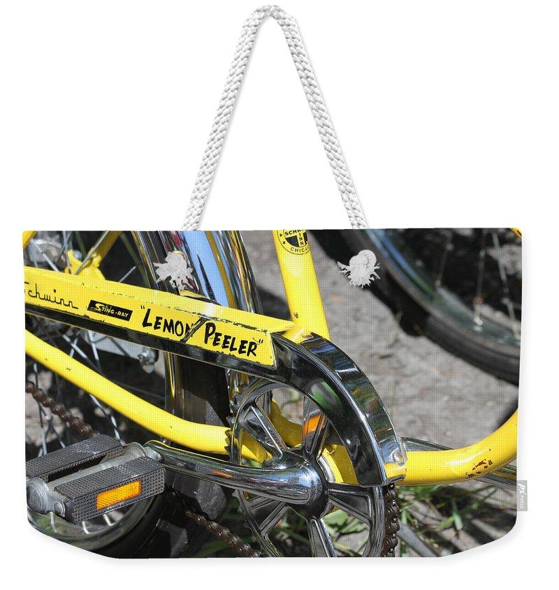 Schwinn Weekender Tote Bag featuring the photograph Lemon Peeler by Lauri Novak