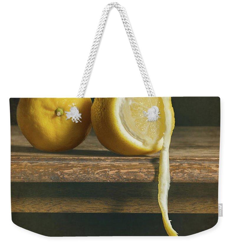 Lemon Weekender Tote Bag featuring the photograph Lemons by Amanda Elwell