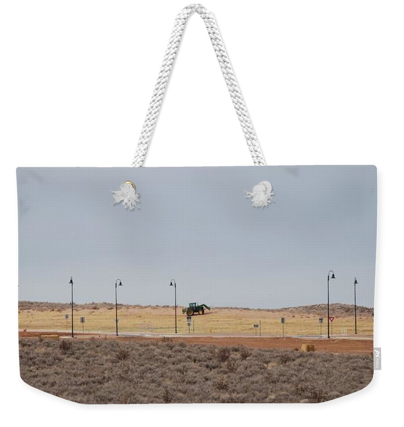 Trackor Weekender Tote Bag featuring the photograph Levels Of Land by Rob Hans