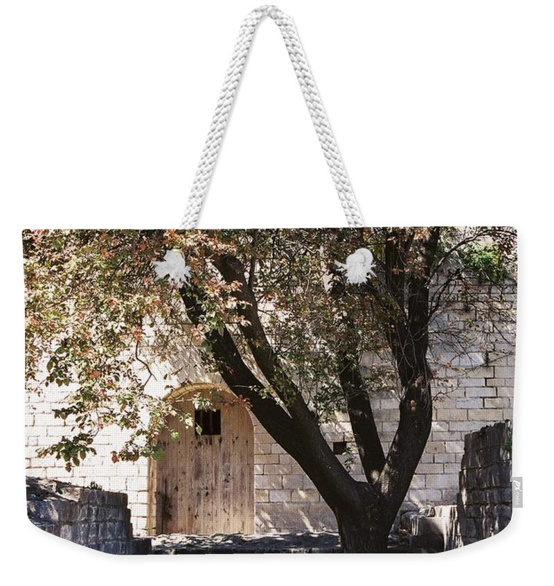 Life Weekender Tote Bag featuring the photograph Life And Death by Nadine Rippelmeyer