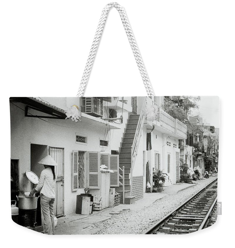Hanoi Weekender Tote Bag featuring the photograph Life In Hanoi by Shaun Higson