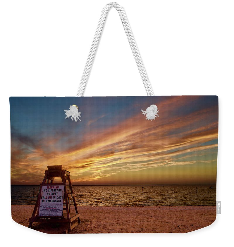 Weekender Tote Bag featuring the photograph Lifeguard by Randy Castaneda