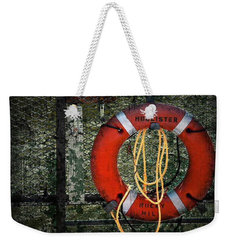 Lifesaver Weekender Tote Bag featuring the photograph Lifesaver by Evelina Kremsdorf