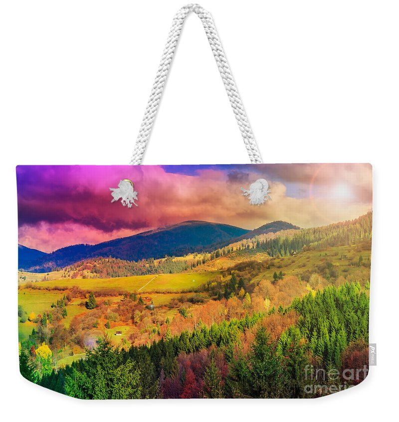 Landscape Weekender Tote Bag featuring the photograph Light Beam Falls On Hillside With Autumn Forest In Mountain by Michael Pelin