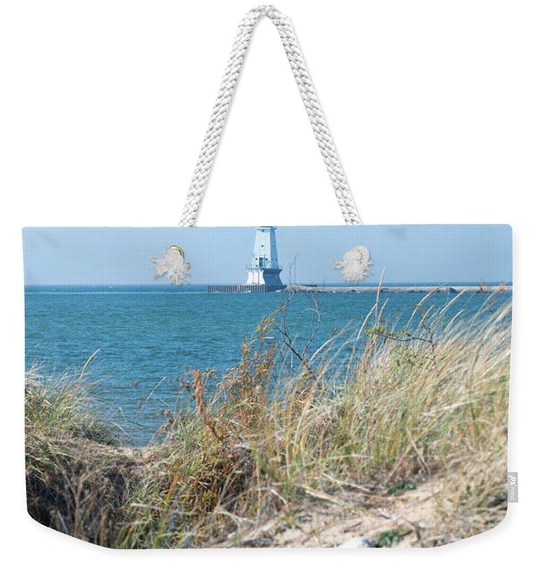 Ludington Weekender Tote Bag featuring the photograph Light Beyond by Linda Kerkau