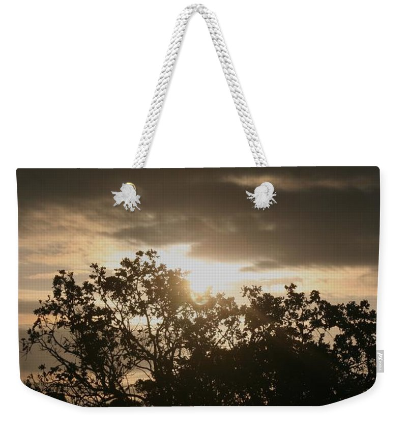 Light Weekender Tote Bag featuring the photograph Light Chasing Away The Darkness by Nadine Rippelmeyer