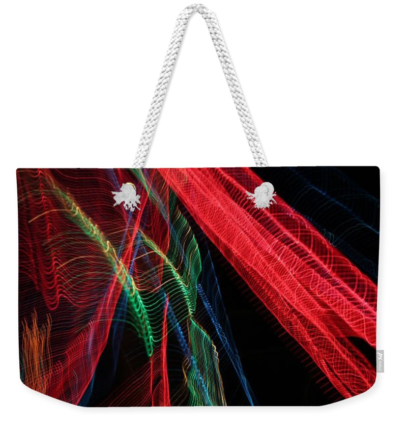 Christmas Weekender Tote Bag featuring the photograph Light Ribbons by Ric Bascobert