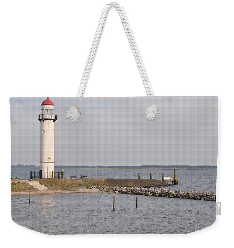 Harbor Weekender Tote Bag featuring the photograph Lighthouse Hellevoetsluis by Eduard Meinema