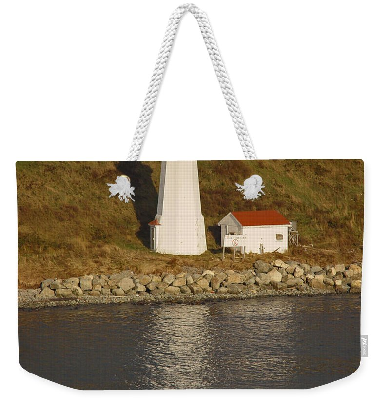 Lighthouse Weekender Tote Bag featuring the photograph Lighthouse In Maine by Heather Coen