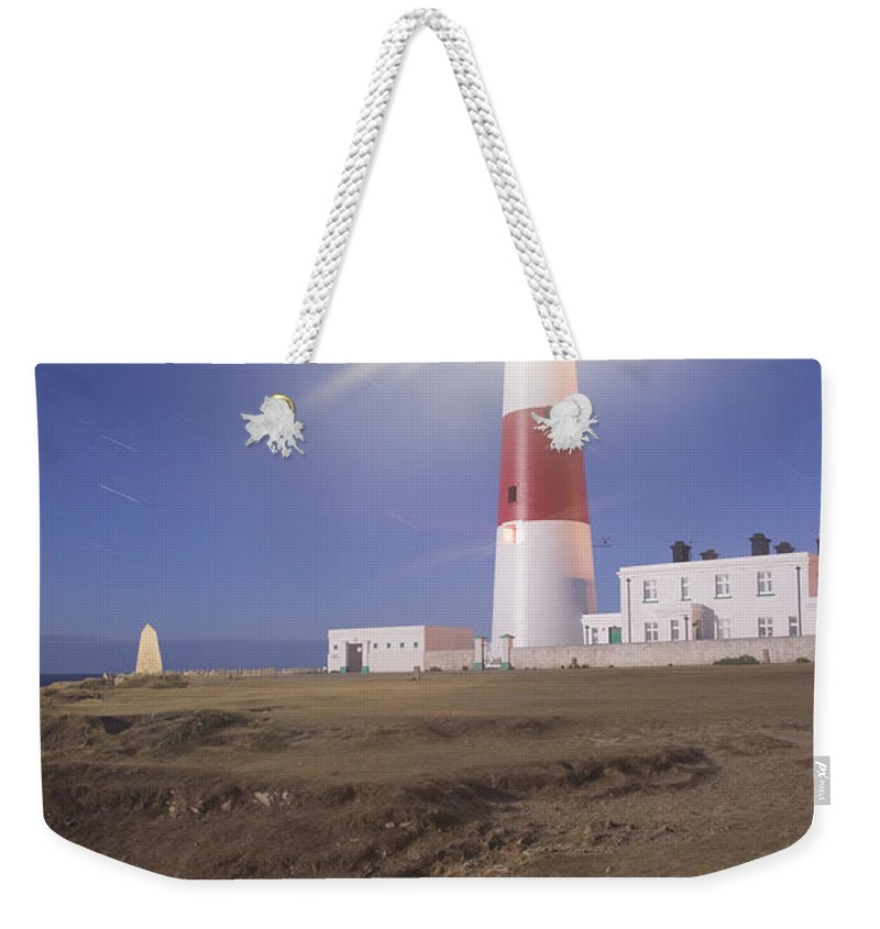 Portland Weekender Tote Bag featuring the photograph Lighthouse In Portland Bill by Ian Middleton