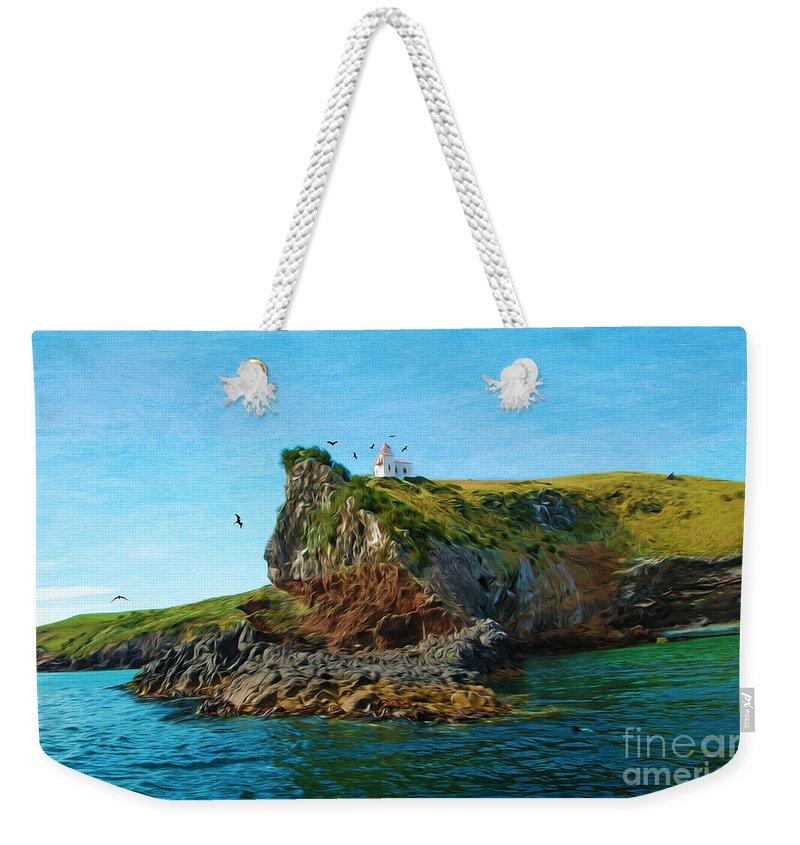 Lighthouse Weekender Tote Bag featuring the photograph Lighthouse On Cliff Dunedin New Zealand by Laura D Young
