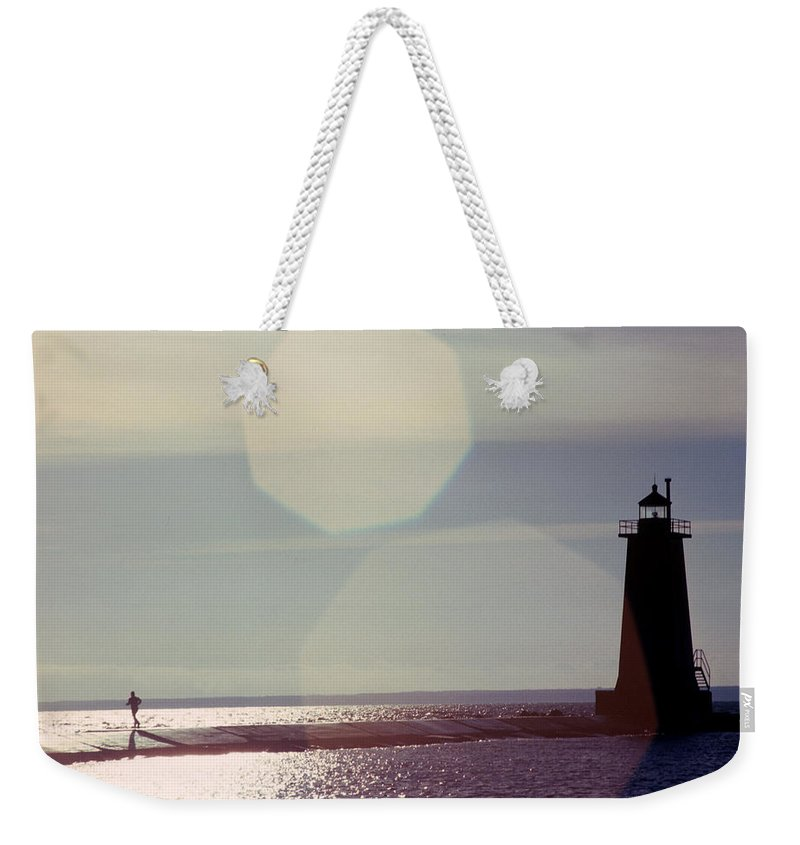 Lighthouse Weekender Tote Bag featuring the photograph Lighthouse Run by Jerry McElroy