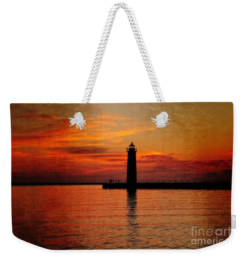 Muskegon Weekender Tote Bag featuring the photograph Lighthouse Silhouette by Emily Kay