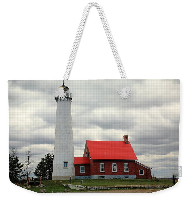 America Weekender Tote Bag featuring the photograph Lighthouse - Tawas Point Michigan by Frank Romeo