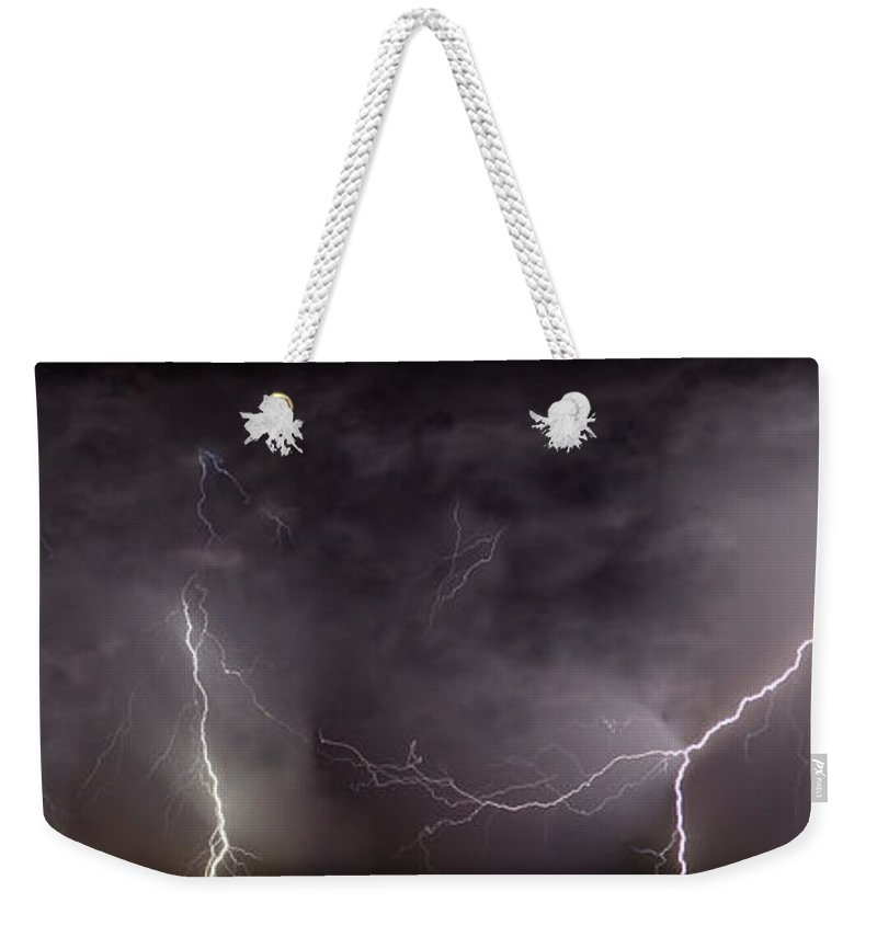 Lightning Weekender Tote Bag featuring the photograph Lightning Over Perris by Anthony Jones