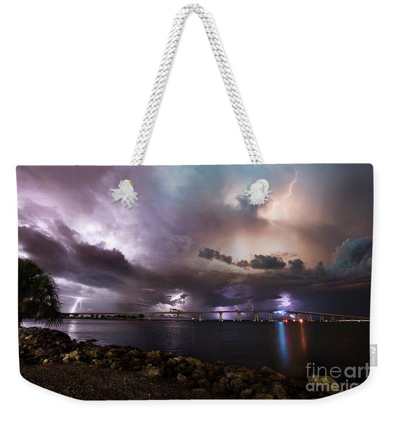 Sanibel Weekender Tote Bag featuring the photograph Lightning Over The Sanibel Bridge by Jon Neidert