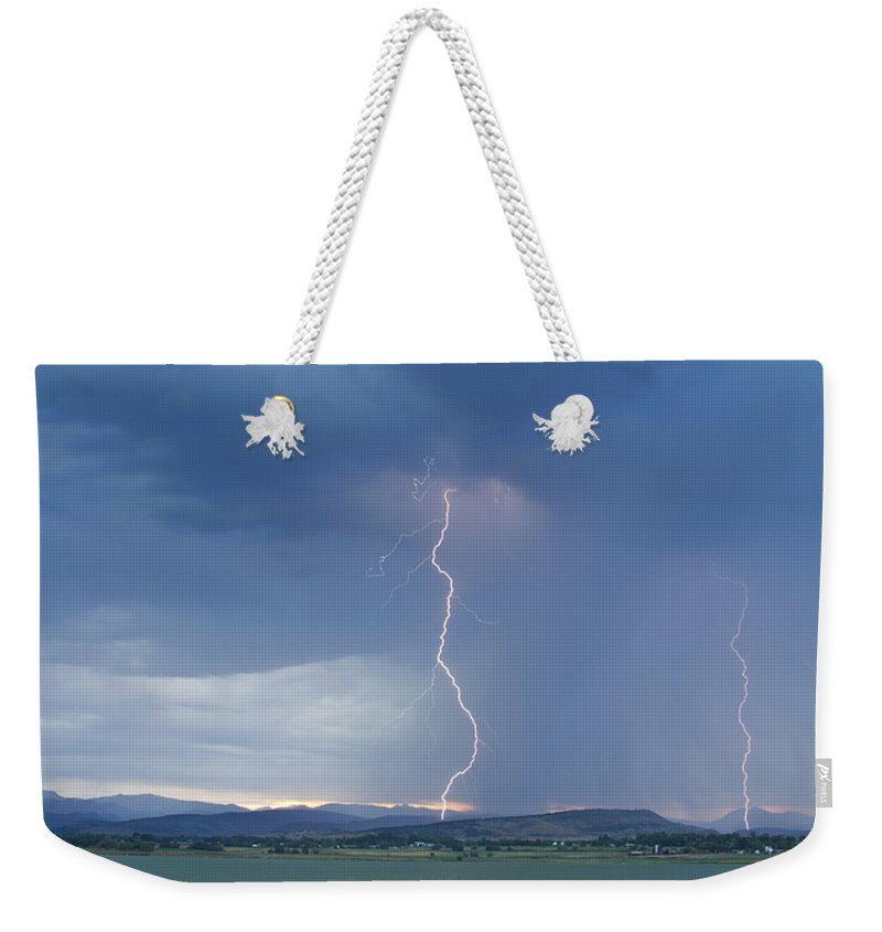 July Weekender Tote Bag featuring the photograph Lightning Striking At Sunset Rocky Mountain Foothills by James BO Insogna