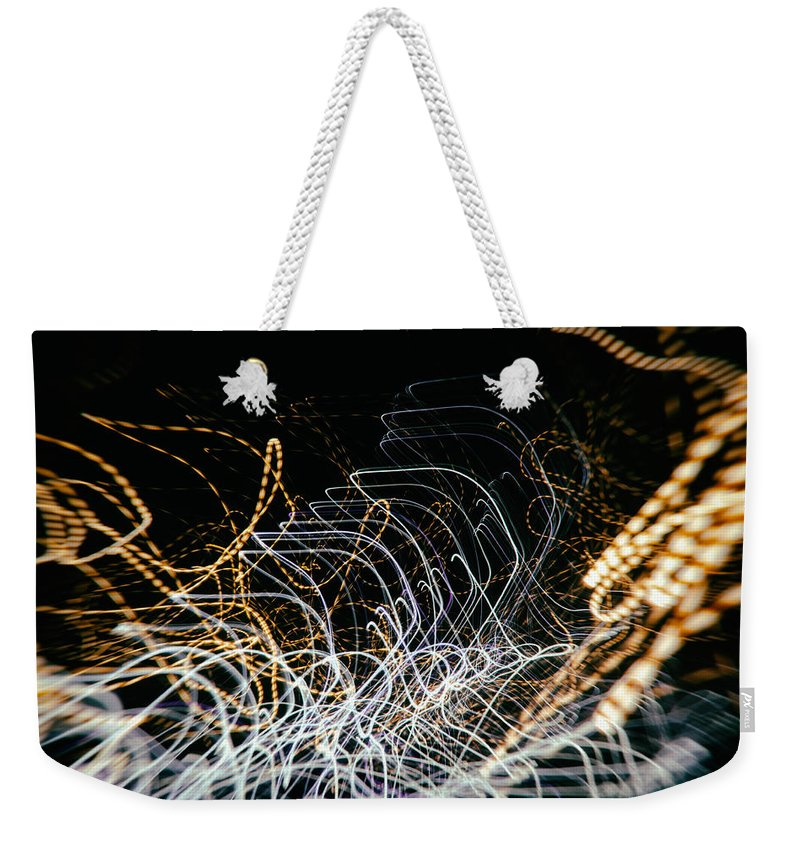 Backgrounds Weekender Tote Bag featuring the photograph Scorpion Sundance by John Williams