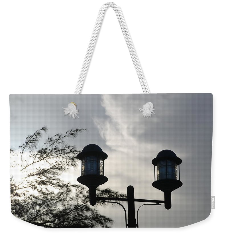 Sunset Weekender Tote Bag featuring the photograph Lights In The Sky by Rob Hans
