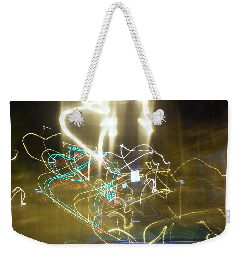 Photograph Weekender Tote Bag featuring the photograph Lights That Attack Cars by Thomas Valentine