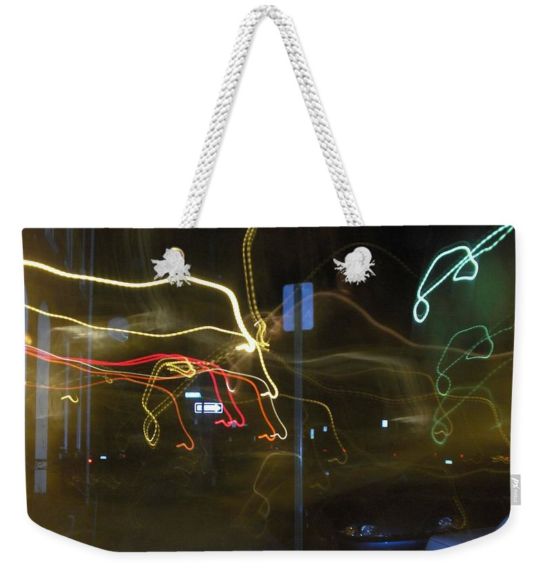 Photograph Weekender Tote Bag featuring the photograph Lights That Attack Cars Two by Thomas Valentine