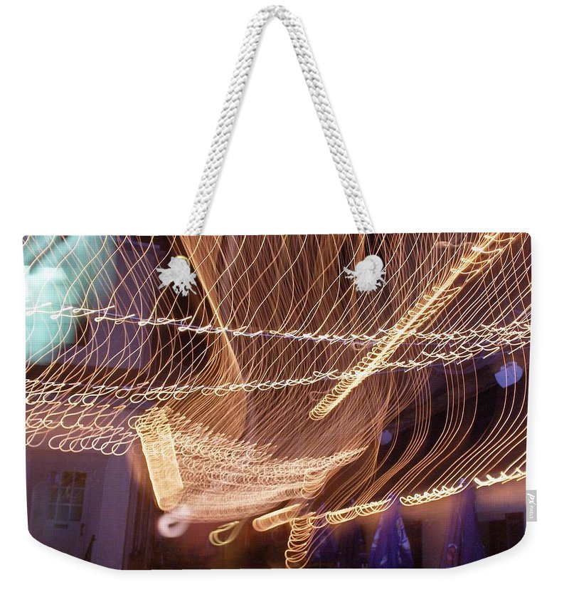Photograph Weekender Tote Bag featuring the photograph Lights That Dance Together by Thomas Valentine