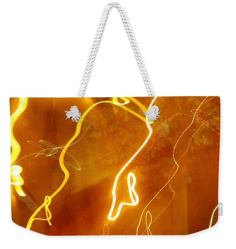 Photograph Weekender Tote Bag featuring the photograph Lights That Eat Trees by Thomas Valentine