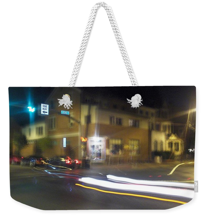 Photograph Weekender Tote Bag featuring the photograph Lights That Race by Thomas Valentine