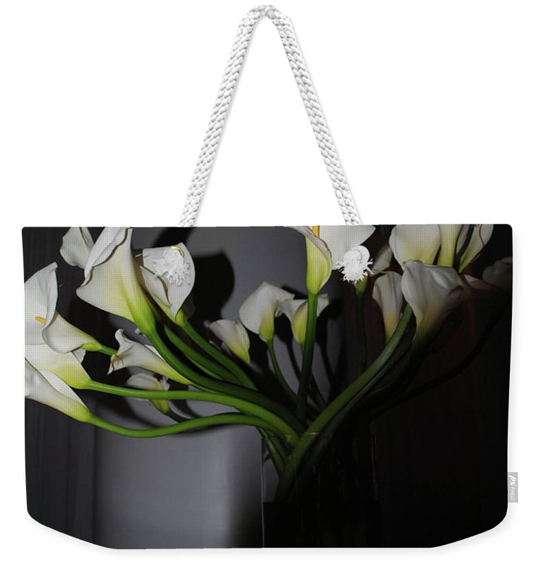 Easter Weekender Tote Bag featuring the photograph Lilly Of The Dark by Jost Houk