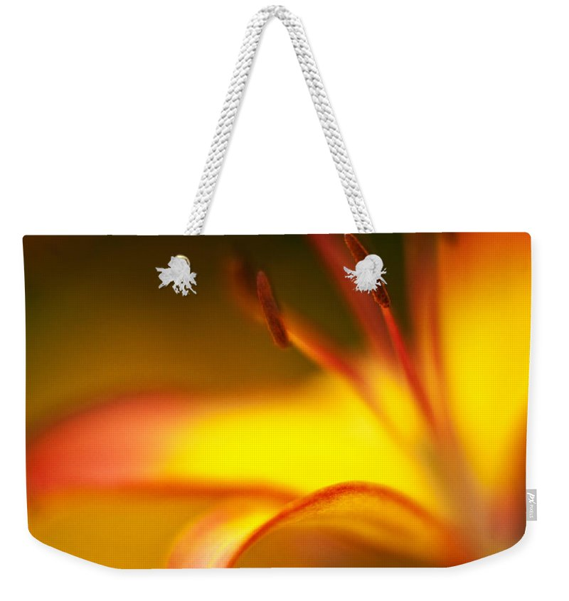 Lilly Weekender Tote Bag featuring the photograph Lily Curls by Mike Reid