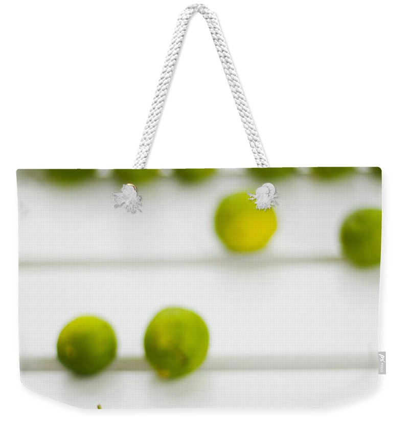 Green Weekender Tote Bag featuring the photograph Lime Green by Skip Hunt