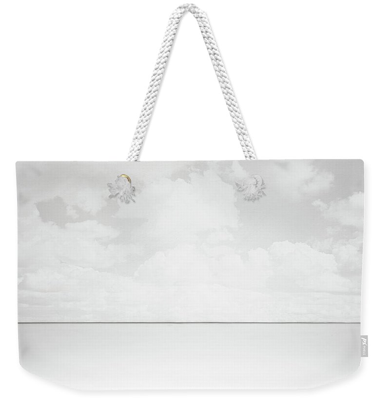 Horizon Weekender Tote Bag featuring the photograph Line Of Sight by Scott Norris